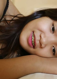 sex pics Young looking Thai girl in braces, shorts , close up